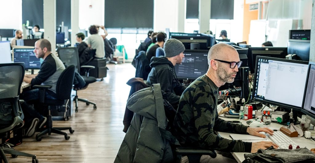 room of programmers working in cubicles